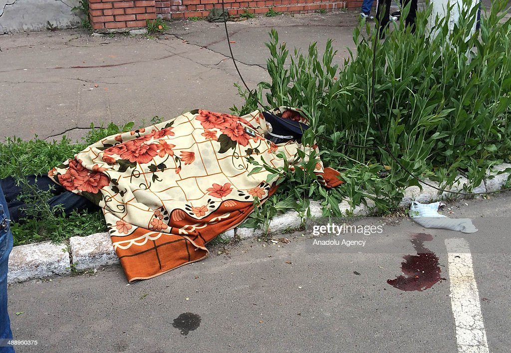 A policeman who died during the clash between Pro-Russians separatists and Ukraine army in Mariupol, Ukraine on 9 May 2014. A Police building was burnt during the clashes.