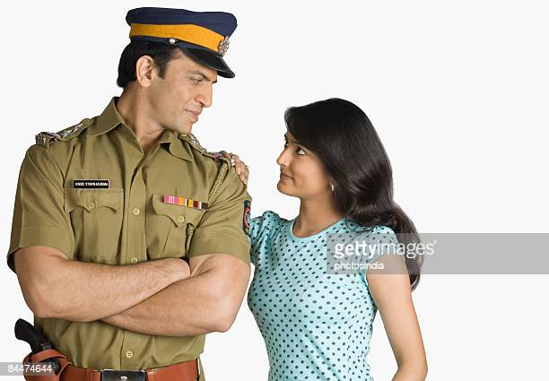 Policeman with a young woman looking at each other