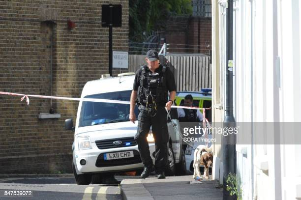 A policeman with his dog is seen around the Parsons Green Underground Station Several injured at Parsons Green as passengers report seeing device on...