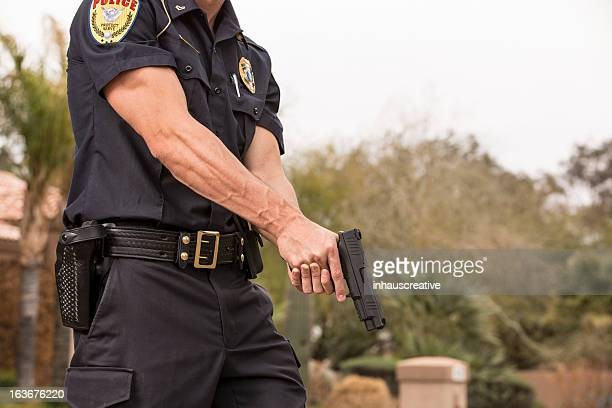policeman with his gun drawn - gun stock pictures, royalty-free photos & images