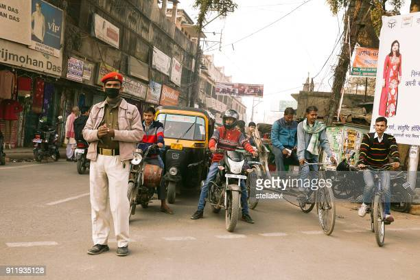 policeman with  protective mask in india - uttar pradesh stock pictures, royalty-free photos & images