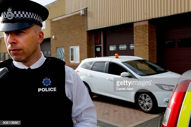 Policeman with unmarked car
