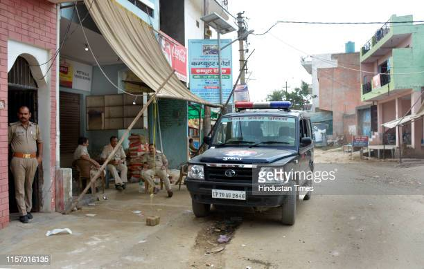 Policemen and a police vehicle seen on the deserted streets of Dasna town after the murder of BJP leader BS Tomar, on July 20, 2019 in Ghaziabad,...
