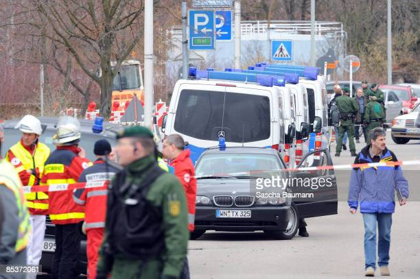 Policemen and ambulance are seen at the crime scene at the Albertville-School Centre on March 11, 2009 in Winnenden near Stuttgart, Germany....