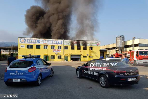 IRENE ROSSANO CALABRIA ITALY Policemen and Carabinieri during the phases of extinguishing a large fire that destroyed a shed with Cash and Carry...