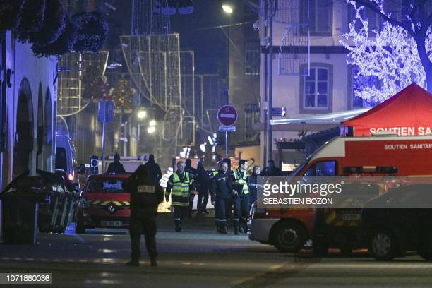 TOPSHOT Policemen and emergency medical response vehicules are seen in the rue des Grandes Arcades in Strasbourg eastern France after a shooting...