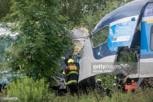 Policemen and firefighters work at the accident site where two trains collided near the village of Milavce between the stations Domazlice and...