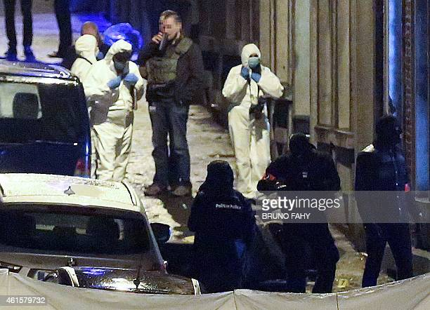 Policemen and forencic police work into a marked up perimeter in Colline street in Verviers eastern Belgium on January 15 after two men were...
