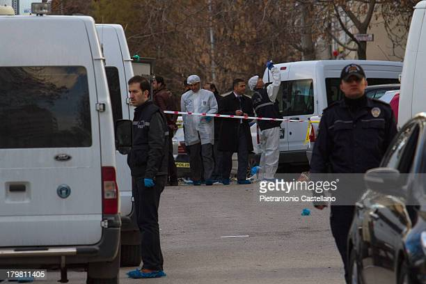CONTENT] Policemen and forensic experts survey the scene of the suicide bombing at US Embassy in Ankara
