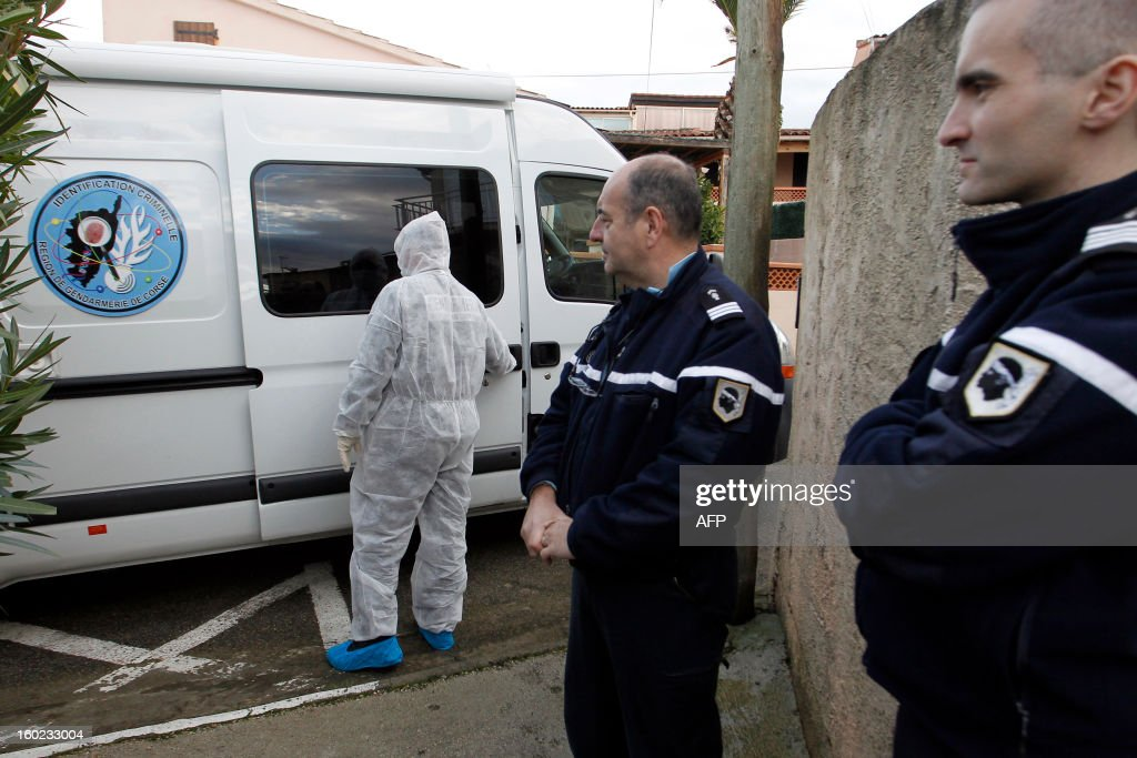 Policemen and forensics investigate around a crime scene, on January 28, 2013, close from Agosta beach in Albitreccia, in the French Mediterranean island of Corsica. A Tunisian-born man, Assen Jamaio, was found dead today in his home probably stabbed to death according to the police.