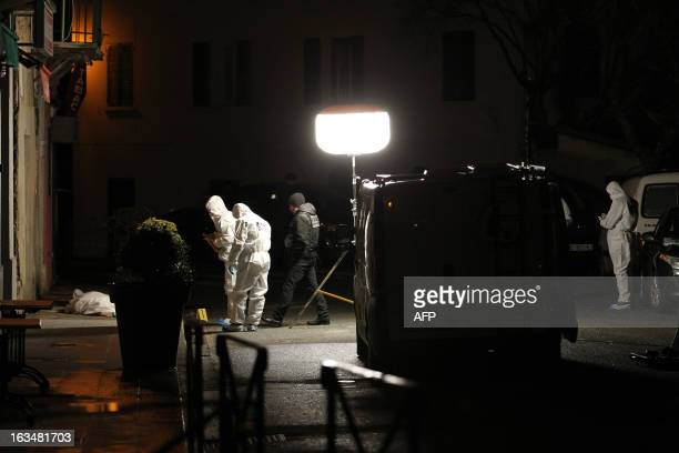 Policemen and forensics investigate around a crime scene where Jerome Salvadori has been shot dead in the street of Venaco village on March 10 in the...