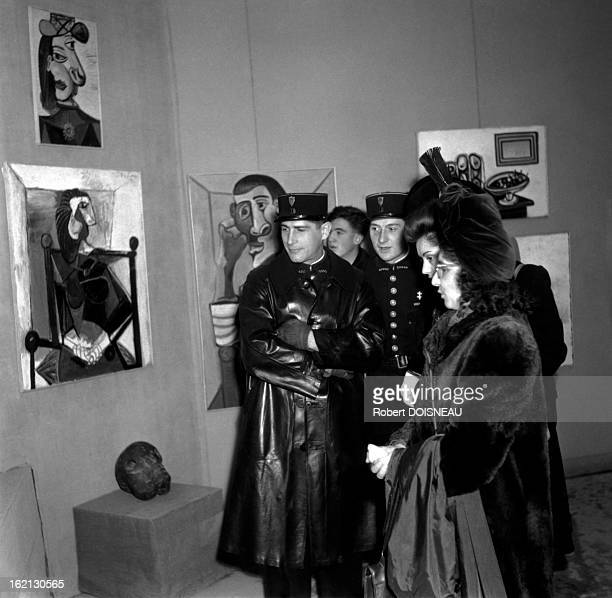 Policemen and women at the Salon d'Automne in 1944 in Paris France
