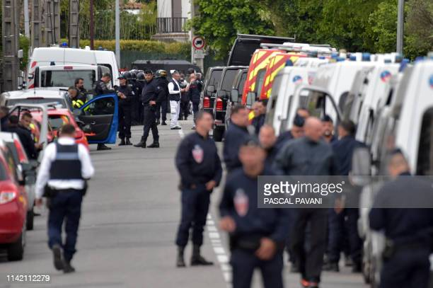 Policemen are at work near a bar where a 17yearold man is holding four persons as hostages on May 7 2019 in Blagnac near Toulouse