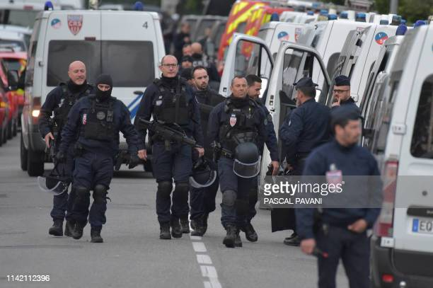 Policemen are at work near a bar where a man is holding four persons as hostages on May 7 2019 in Blagnac near Toulouse