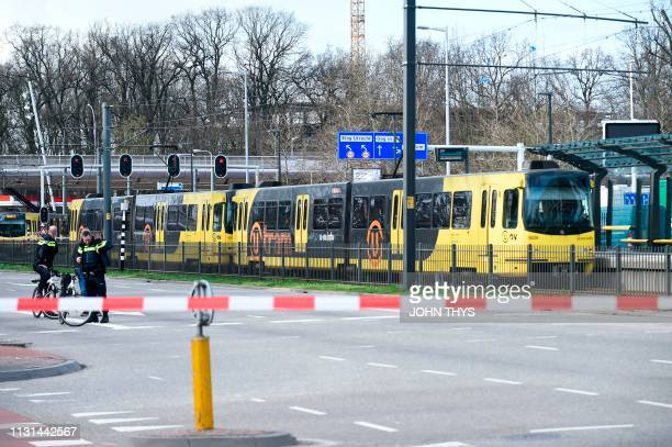 Policemen are at work on March 18 2019 in Utrecht near a tram where a gunman opened fire killing at least three persons and wounding several in what...