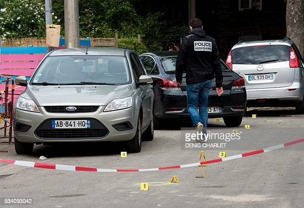 Policemen are at work, on May 25, 2016 in Lille at the scene where a man was shot dead by policemen during an anti-drug operation overnight. / AFP /...