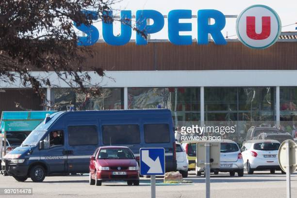 Policemen are at work outside the Super U supermarket of Trebes southern France on March 23 after special forces killed a gunman who had taken...