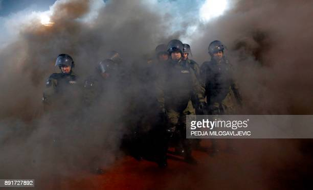 Policemen are engulfed in smoke after two groups of Partizan Belgrade's hooligans clashed with each other during the Serbian Superleague derby...