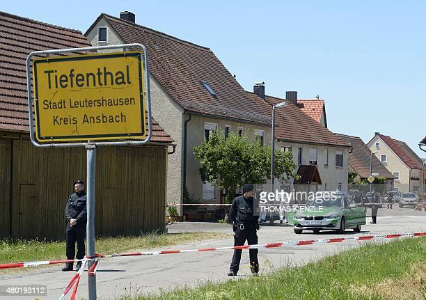 Policemen are seen at a crime scene in TiefenthalLeutershausen near Ansbach southern Germany after a gunman in a car killed a woman and a cyclist in...