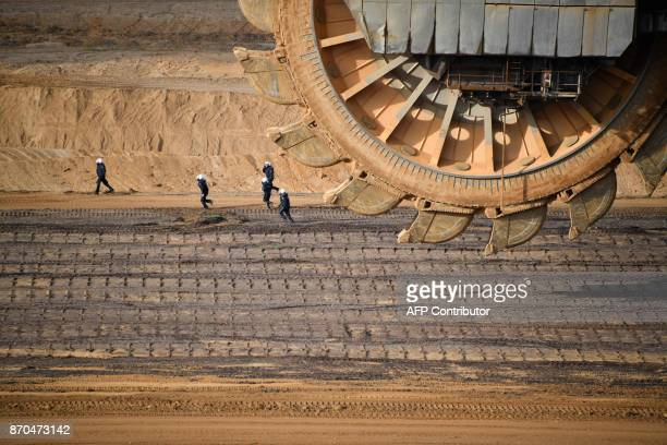 Policemen are seen behind a bucketwheel excavator as they secure the area of the Hambach lignite open pit mine near Elsdorf western Germany on...