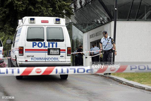 Policemen are seen in front of the Munch Museum as they investigate the robbery of several Edvard Munch paintings 22 August 2004 Edvard Munch's...