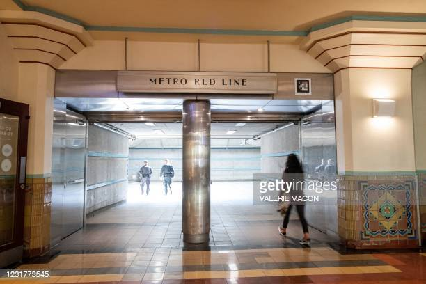 Policemen are seen on the platform as a passenger walks through the Red Line entrance in the Union Station, downtown L.A. Where part of the Oscars...