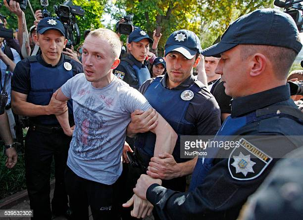 Policemen arrest a antigay protester during the Gay pride parade in Kiev Ukraine12 June2016 Representatives of LGBT gay rights activists and their...