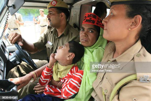 Policemen arrest a Bhopal gas tragedy victim from outside Indian Prime Minister's house on May 5 2008 in New Delhi India More than 40 children of...