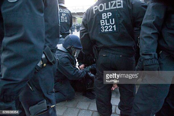 Policemen arrest a demonstrator during the clashes occurred in the Kreuzberg district on May 1 2016 in Berlin Germany May Day or International...