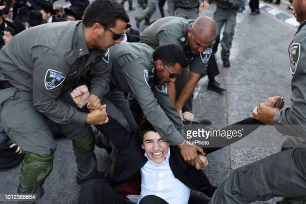 Policemen arrest a protester during protest against the arrest of ultra orthodox men who failed to show for their army draft in BneiBrak August 6...