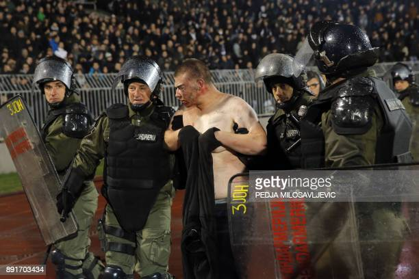 Policemen arrest a supporter after clashes between Red star Belgrade's and Partizan Belgrade's hooligans during the Serbian Superleague derby...
