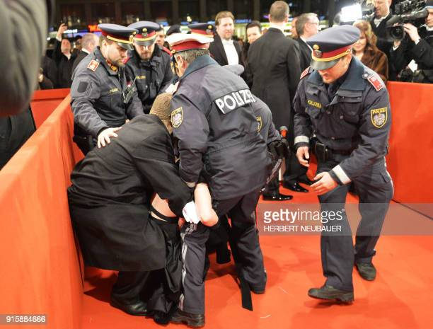 Policemen arrest an activist on the red carpet prior the opening of the Opera Ball 2018 the sumptuous highlight of the Austrian capital's ball season...