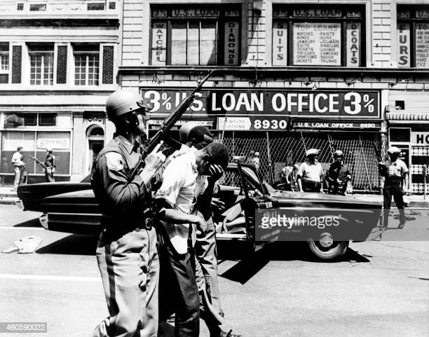Policemen arrest black suspects in a Detroit street on July 25 1967 during riots that erupted in Detroit following a police operation / AFP PHOTO /...