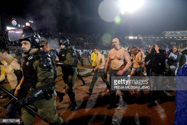 Policemen arrest Partizan Belgrade's hooligans after clashes between two groups of Partizan Belgrade's supporters during the Serbian Superleague...