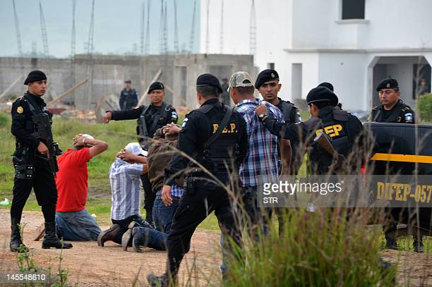 Policemen arrest some of seven alleged members of the drug gang Los Zetas in Jalapa 100 km west Guatemala city on June 1 2012 Guatemalan security...