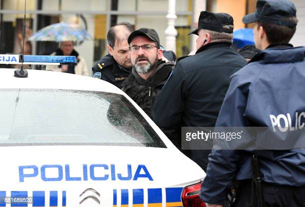 Policemen arrests a man screaming on the Josip Jelacic's main square in Zagreb on November 29 2017 Man started screaming after he heard that Slobodan...