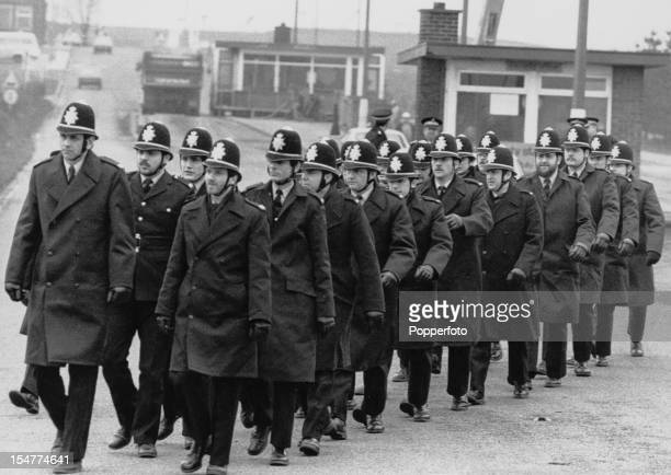 Policemen arrive at Thoresby Colliery in Nottinghamshire to ensure the safety of strikebreakers passing through the picket lines during the miners'...