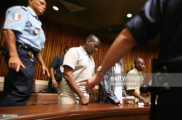 Policemen arrive with the ousted leader of the Comoros island of Anjouan Mohamed Bacar in a room of the Courthouse in Saint Denis on the French...