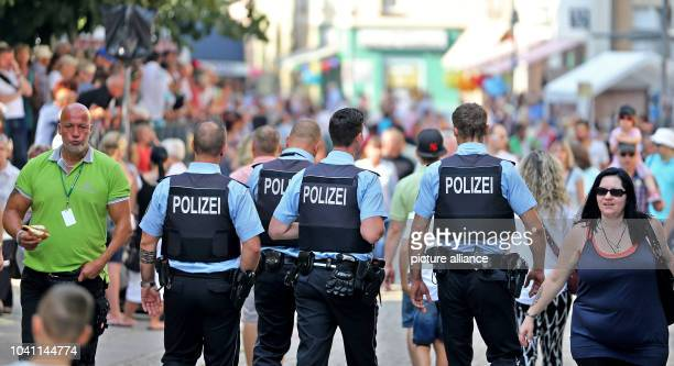 Policemen at the festival parade for the 20th Day of SaxonyAnhalt in Sangershausen Germany 11 September 2016 The festival parade with 4500...