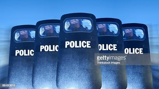 Policemen behind shields