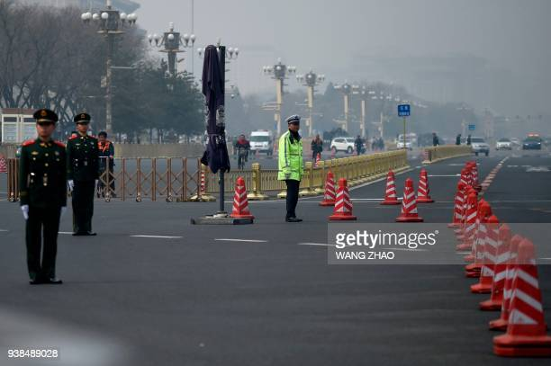 Policemen block a road near Tiananmen Square in Beijing on March 27 2018 Speculation intensified on March 27 2018 that North Korean leader Kim JongUn...