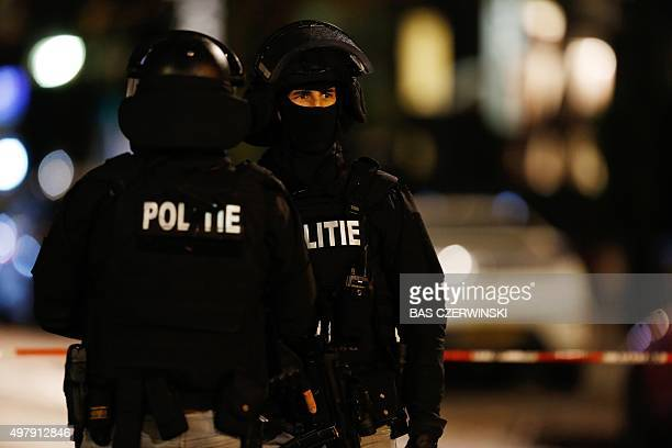 Policemen block a street as police does investigation around a car with a Belgium number plate at the Westersingel in Rotterdam The Netherlands on...