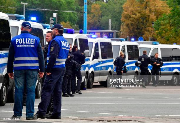 Policemen block a street in Chemnitz, eastern Germany, on September 1, 2018 ahead a protest of the far-right Alternative for Germany party and...