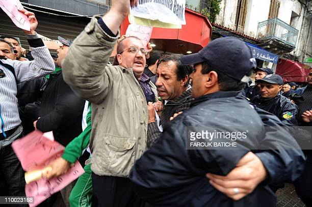 Policemen block demonstrators who attempted to stage a rally on March 12 2011 in Algiers Police in Algeria launched a massive security operation to...