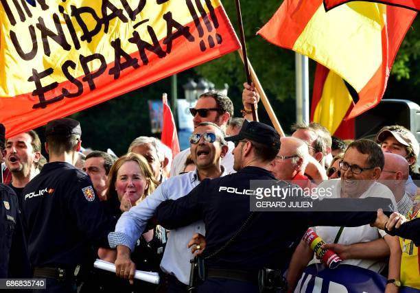 Policemen block farright demonstrators protesting in front of the Madrid City Hall at the Cibeles palace against the presence of President of the...