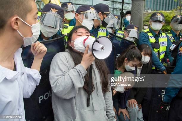 Policemen block student protesters during a demo against the Japanese government in front of the Japanese Embassy in Seoul. Japan recently decided to...