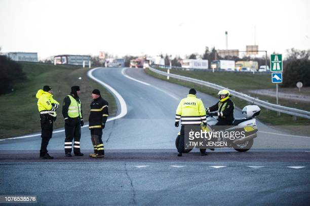 Policemen block the road after access to the Great Belt Bridge was closed following a railway accident on January 2 2019 in Nyborg Denmark Several...