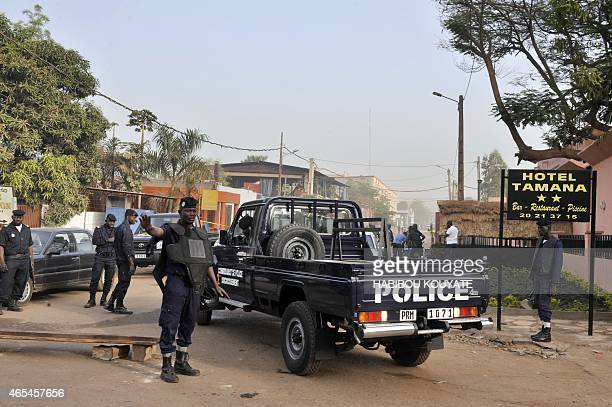 Policemen block the street near La Terrasse restaurant in Bamako on March 7 after five people including a French and a Belgian national were shot...