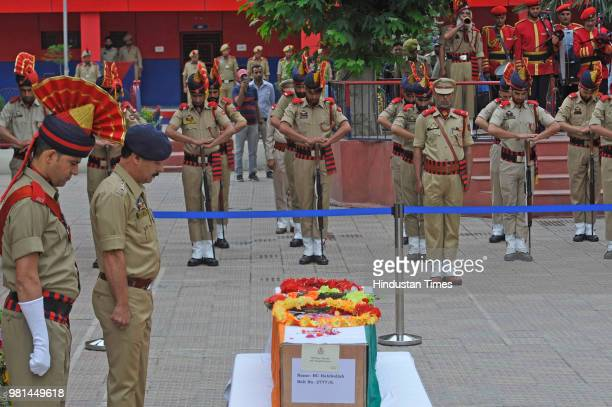 Police officers carry the coffin containing the body of slain policeman Habibullah during the wreath laying ceremony at the District Police Lines on...