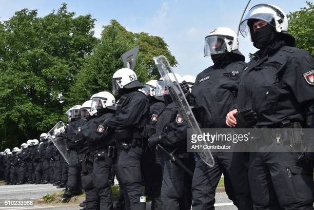 Policemen build a cordon as they secure the area during a protest on July 7 2017 in Hamburg northern Germany where leaders of the world's top...